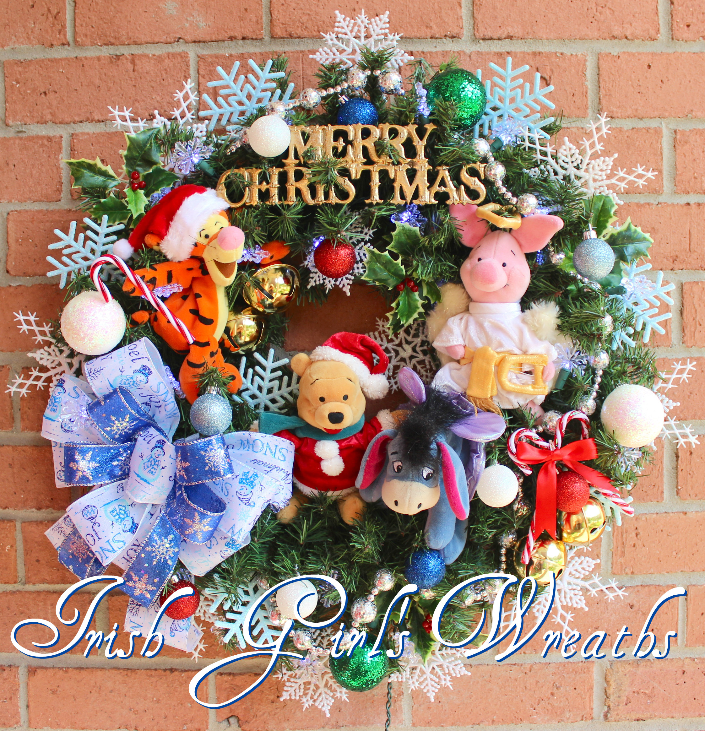 Winnie the Pooh & Friends Christmas Wreath, Pre-lit with LED Snowflake lights, Eeyore, Piglet, Tigger